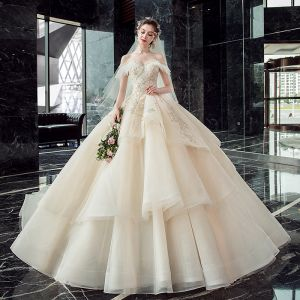 Chic / Beautiful Champagne Wedding Dresses 2019 Ball Gown Off-The-Shoulder Short Sleeve Backless Appliques Lace Pearl Beading Glitter Tulle Cathedral Train