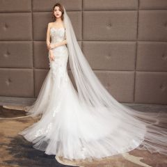 Charming Ivory Wedding Dresses 2019 Trumpet / Mermaid Sweetheart Beading Sequins Lace Flower Sleeveless Backless Court Train