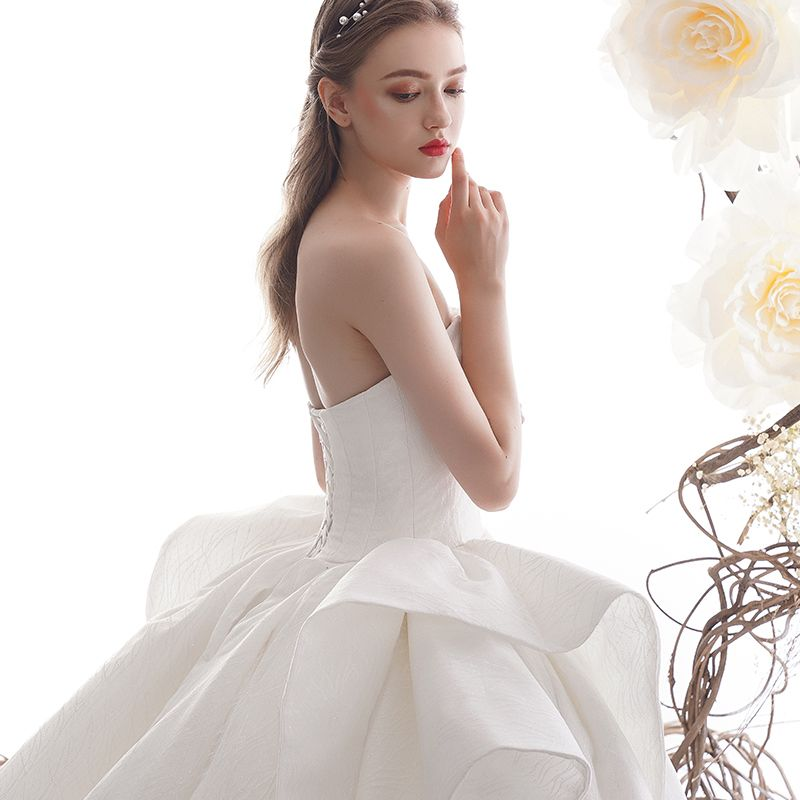 High-end Ivory Wedding Dresses 2019 Ball Gown Strapless Sleeveless Backless Glitter Tulle Cathedral Train Ruffle