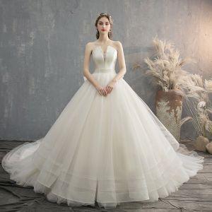 Charmig Champagne Bröllopsklänningar 2019 Prinsessa Axelbandslös Rosett Ärmlös Halterneck Cathedral Train