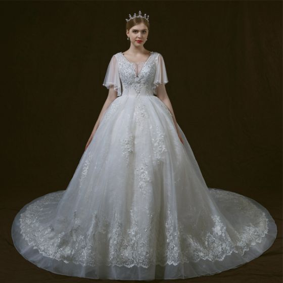 Luxury / Gorgeous Ivory Wedding Dresses 2018 Ball Gown See-through V-Neck Short Sleeve Backless Appliques Lace Sequins Beading Cathedral Train Ruffle