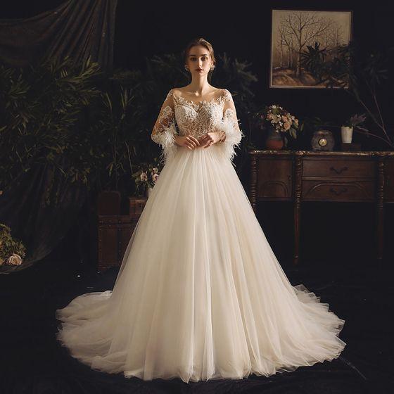 Iluzja Szampan Przezroczyste Suknie Ślubne 2019 Princessa Kwadratowy Dekolt Długie Rękawy Pióro Bez Pleców Aplikacje Z Koronki Przebili Frezowanie Trenem Sąd