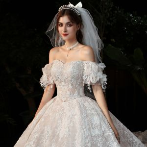 Romantic Champagne Lace Bridal Wedding Dresses 2020 Ball Gown Off-The-Shoulder Short Sleeve Backless Appliques Lace Beading Cathedral Train Ruffle