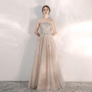 Elegante Champagner Abendkleider 2020 A Linie Bandeau Ärmellos Pailletten Perlenstickerei Lange Rüschen Rückenfreies Festliche Kleider