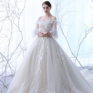 Chic / Beautiful Champagne See-through Wedding Dresses 2018 Ball Gown Off-The-Shoulder 3/4 Sleeve Backless Appliques Lace Beading Ruffle Cathedral Train