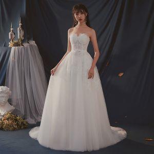 Modest / Simple Ivory Wedding Dresses 2019 A-Line / Princess Sweetheart Sleeveless Backless Appliques Lace Bow Sash Sweep Train Ruffle