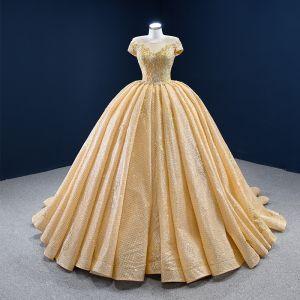 Luksusowe Złote ślubna Suknie Ślubne 2020 Suknia Balowa Przezroczyste Wycięciem Kótkie Rękawy Bez Pleców Aplikacje Z Koronki Frezowanie Cekinami Tiulowe Trenem Kaplica Wzburzyć