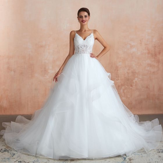 Illusion Ivory Wedding Dresses 2020 Ball Gown Spaghetti Straps Sleeveless Backless Appliques Lace Chapel Train Ruffle