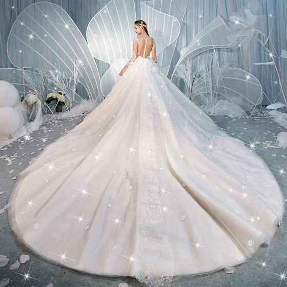 Charming Champagne See-through Backless Wedding Dresses 2019 Ball Gown Scoop Neck Long Sleeve Glitter Tulle Appliques Lace Beading Cathedral Train Ruffle