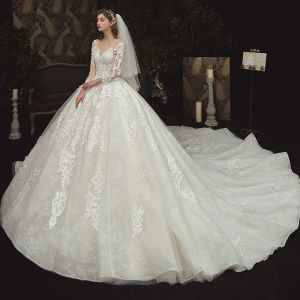 Charming Champagne See-through Bridal Wedding Dresses 2020 Ball Gown Scoop Neck 3/4 Sleeve Appliques Lace Beading Pearl Cathedral Train Ruffle