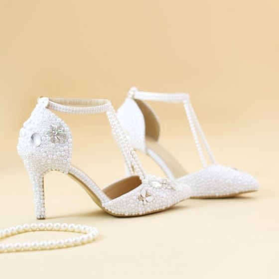 528a34ed0480 charming-white-wedding-shoes-2019-pearl-ankle-strap-t-strap-rhinestone-8-cm- stiletto-heels-pointed-toe-wedding-high-heels-560x560.jpg