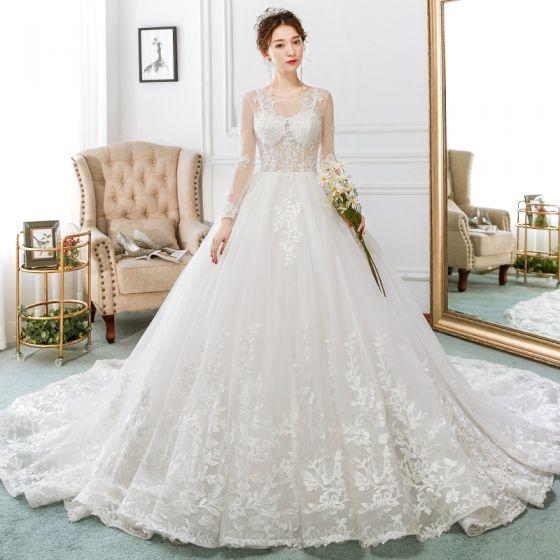 Elegantes Marfil Vestidos De Novia 2018 Ball Gown Con Encaje Apliques Transparentes Scoop Escote Sin Espalda Manga Larga Cathedral Train Boda
