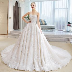 Luksusowe Kość Słoniowa Przezroczyste Suknie Ślubne 2018 Suknia Balowa Wycięciem Bez Rękawów Bez Pleców Aplikacje Z Koronki Rhinestone Wzburzyć Trenem Katedra