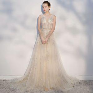 Eleganta Champagne Genomskinliga Bröllopsklänningar 2018 Prinsessa Stjärna Rosett Urringning Halterneck Ärmlös Domstol Tåg Bröllop