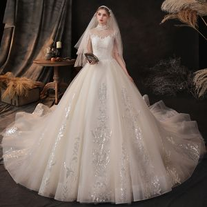 Vintage / Retro Champagne See-through Bridal Wedding Dresses 2020 Ball Gown High Neck 1/2 Sleeves Backless Appliques Lace Beading Cathedral Train Ruffle
