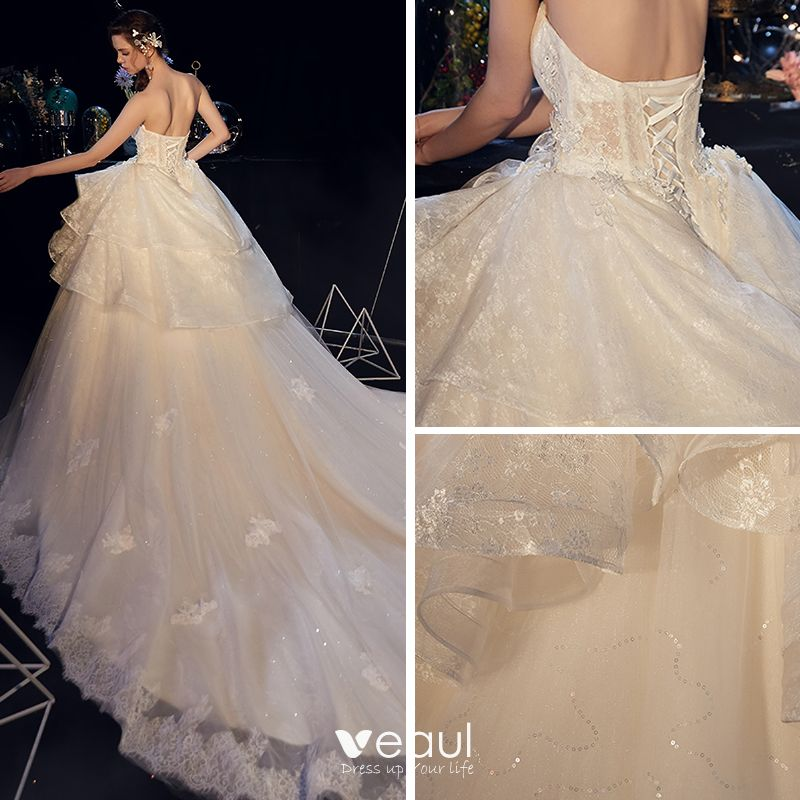Elegant Ivory Wedding Dresses 2019 Ball Gown Sweetheart Sleeveless Backless Appliques Lace Glitter Tulle Cathedral Train Ruffle