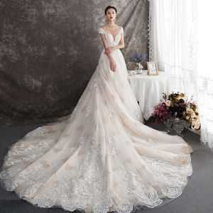 Elegant Champagne Wedding Dresses 2019 A-Line / Princess See-through Deep V-Neck Cap Sleeves Backless Appliques Lace Beading Chapel Train Ruffle