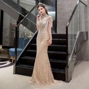 Luxus / Herrlich Gold Durchsichtige Abendkleider 2019 Meerjungfrau Stehkragen Ärmellos Handgefertigt Perlenstickerei Quaste Sweep / Pinsel Zug Festliche Kleider