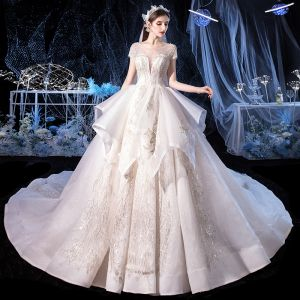 Elegant Ivory Bridal Wedding Dresses 2020 Ball Gown See-through Scoop Neck Short Sleeve Backless Glitter Tulle Appliques Lace Beading Cathedral Train Cascading Ruffles