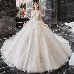 Best Champagne Bridal Wedding Dresses 2020 Ball Gown See-through Scoop Neck Long Sleeve Backless Sequins Beading Glitter Tulle Cathedral Train Ruffle