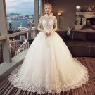 Vintage Ivory Pierced Wedding Dresses 2018 Ball Gown High Neck Short Sleeve Backless Appliques Lace Pearl Beading Tassel Royal Train