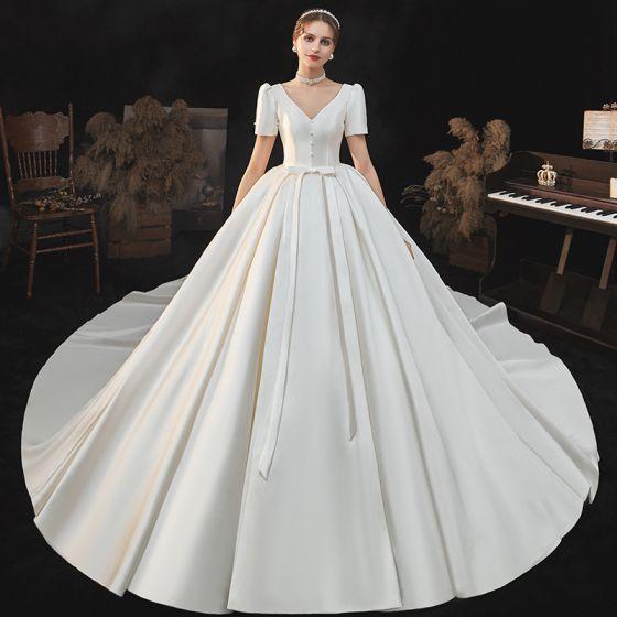Elegant Modest / Simple Satin Ivory Bow Wedding Dresses 2021 Ball Gown V-Neck Short Sleeve Backless Royal Train Wedding