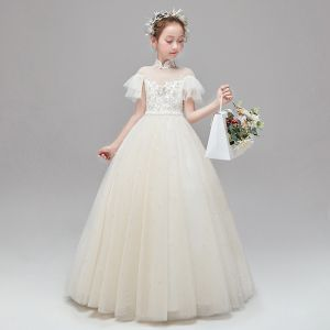 Schöne Champagner Blumenmädchenkleider 2020 A Linie Durchsichtige Stehkragen Kurze Ärmel Applikationen Spitze Perlenstickerei Perle Lange Rüschen