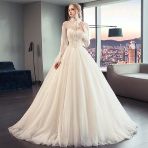 Vintage / Retro Champagne See-through Wedding Dresses 2019 A-Line / Princess High Neck Puffy Long Sleeve Pearl Beading Chapel Train Ruffle