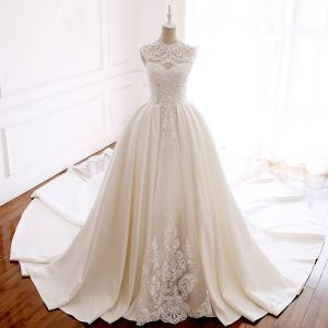 Luxury / Gorgeous Ivory Pierced Wedding Dresses 2018 Ball Gown High Neck Sleeveless Appliques Lace Crystal Beading Pearl Royal Train Ruffle