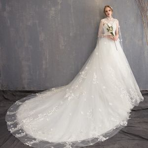Charming White Wedding Dresses 2018 Ball Gown Lace Appliques Beading Crystal Pearl High Neck Sleeveless Backless Watteau Train Wedding