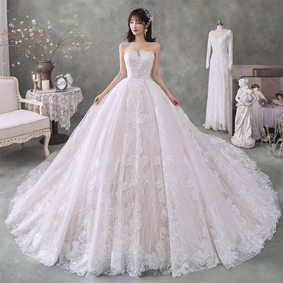 Best Champagne Bridal Wedding Dresses 2020 Ball Gown Sweetheart Sleeveless Backless Flower Appliques Lace Cathedral Train Ruffle