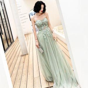 Illusion Grün Abendkleider 2019 A Linie Herz-Ausschnitt Ärmellos Applikationen Spitze Perlenstickerei Sweep / Pinsel Zug Rüschen Rückenfreies Festliche Kleider
