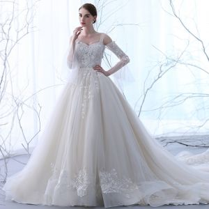 Chic / Beautiful Champagne See-through Wedding Dresses 2018 Ball Gown Strapless Long Sleeve Backless Appliques Lace Ruffle Cathedral Train