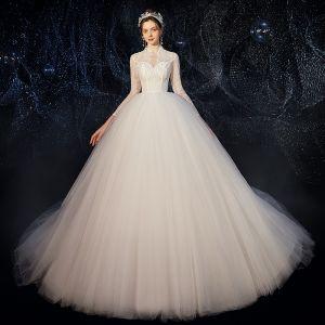 Niedrogie Białe Ogród / Outdoor Przezroczyste Suknie Ślubne 2020 Suknia Balowa Wysokiej Szyi 3/4 Rękawy Frezowanie Perła Trenem Sweep Wzburzyć