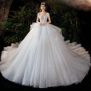 Romantisch Witte Bruids Trouwjurken 2020 Baljurk Doorzichtige Ronde Hals Korte Mouwen Ruglooze Kralen Glans Tule Cathedral Train Ruche