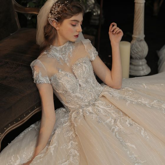 Luxury / Gorgeous Champagne See-through Bridal Wedding Dresses 2020 Ball Gown High Neck Short Sleeve Backless Appliques Lace Handmade  Beading Glitter Tulle Cathedral Train
