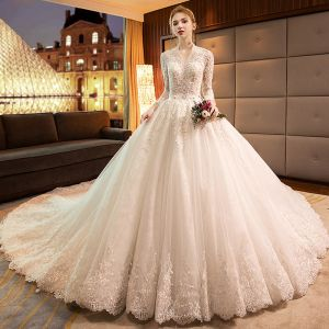 Luxury / Gorgeous Ivory Wedding Dresses 2019 A-Line / Princess V-Neck Beading Sequins Lace Flower Long Sleeve Backless Cathedral Train