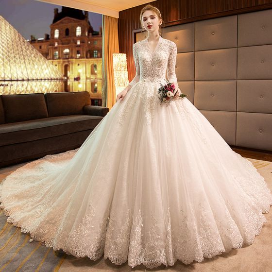 f90f91a8 luxury-gorgeous-ivory-wedding-dresses-2019-a-line-princess-v-neck-beading- sequins-lace-flower-long-sleeve-backless-cathedral-train-560x560.jpg