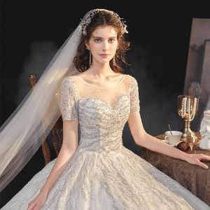 Elegant Champagne Bridal Wedding Dresses 2020 Ball Gown See-through Scoop Neck Short Sleeve Backless Sequins Beading Glitter Tulle Cathedral Train Ruffle