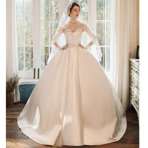 Chic / Beautiful Ivory Satin Bridal Wedding Dresses 2020 Ball Gown Sweetheart Sleeveless Backless Beading Pearl Bow Sash Sweep Train Ruffle