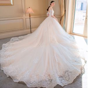 Elegant Champagne Wedding Dresses 2018 Ball Gown Lace Appliques Spaghetti Straps Backless Cathedral Train Short Sleeve Wedding