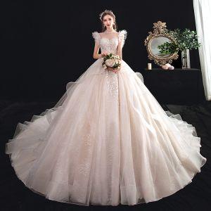 Piękne Przezroczyste Szampan Suknie Ślubne 2020 Suknia Balowa Wysokiej Szyi Bez Rękawów Bez Pleców Aplikacje Z Koronki Frezowanie Trenem Katedra Wzburzyć