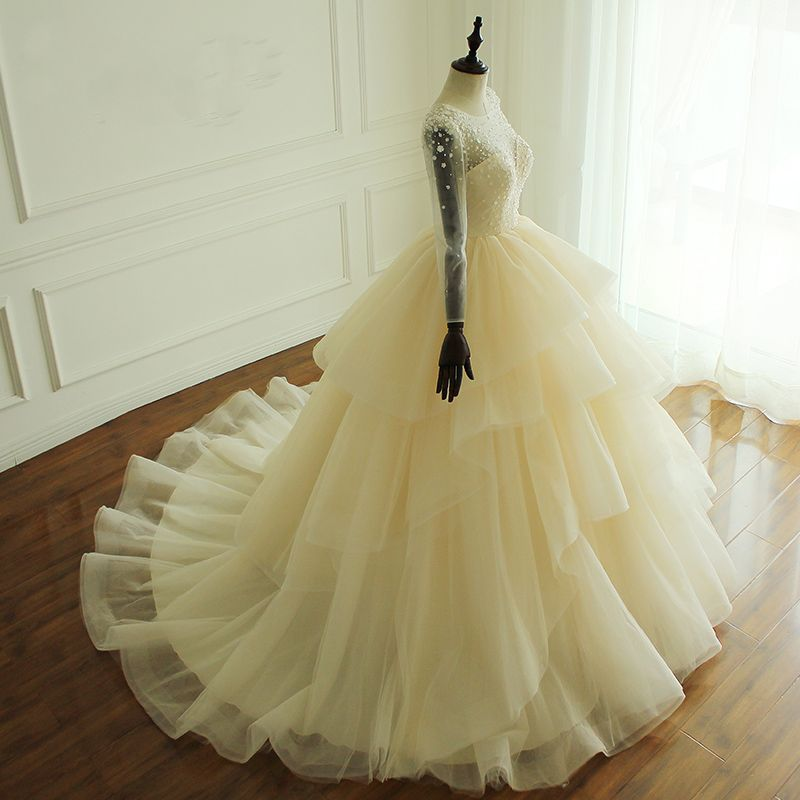 Luxury / Gorgeous Champagne Wedding Dresses 2017 Scoop Neck Long Sleeve Beading Artificial Flowers Backless Cascading Ruffles Tulle Ball Gown Chapel Train