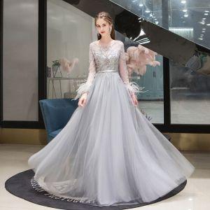 Haut de Gamme Gris Transparentes Robe De Soirée 2020 Princesse Encolure Dégagée Manches Longues Plumes Perlage Longue Volants Robe De Ceremonie