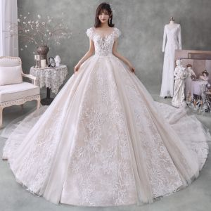 Romantic Champagne Bridal Wedding Dresses 2020 Ball Gown See-through Square Neckline Sleeveless Backless Appliques Lace Beading Glitter Tulle Royal Train