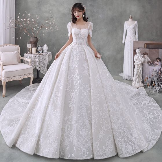 Victorian Style Ivory Bridal Wedding Dresses 2020 Ball Gown See-through Scoop Neck Puffy Short Sleeve Backless Beading Tassel Glitter Tulle Cathedral Train Ruffle