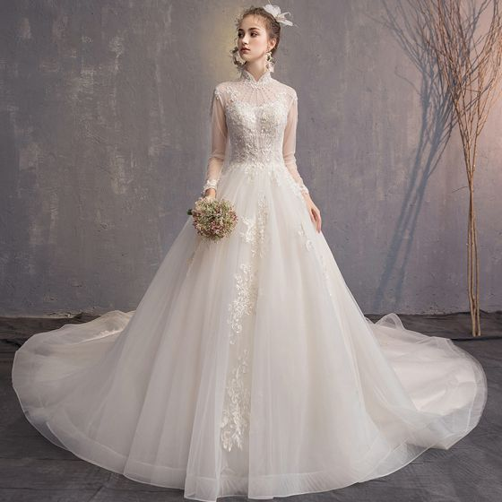 High Neck Wedding Dress.Elegant Champagne Wedding Dresses 2019 A Line Princess High Neck Beading Pearl Tassel Lace Flower Long Sleeve Backless Cathedral Train