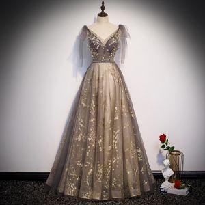 Schöne Grau Gold Durchsichtige Abendkleider 2020 A Linie V-Ausschnitt Ärmellos Glanz Tülle Perlenstickerei Stoffgürtel Lange Rüschen Rückenfreies Festliche Kleider