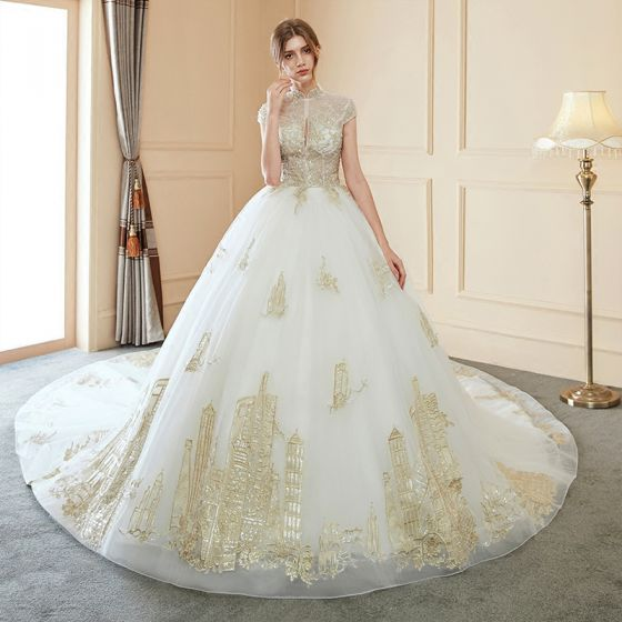 35273cb2541e chinese-style-illusion-ivory-wedding-dresses-2018-ball-gown-high-neck -cap-sleeves-backless-beading-gold-appliques-lace-royal-train-560x560.jpg