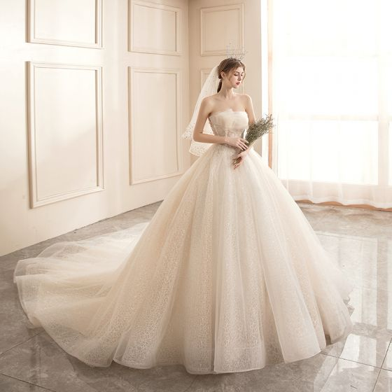 Affordable Champagne Bridal Wedding Dresses 2020 Ball Gown Strapless Sleeveless Backless Appliques Lace Beading Glitter Tulle Chapel Train Ruffle